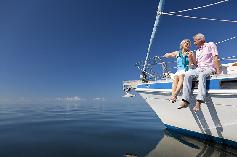 Retired couple relaxing on a boat