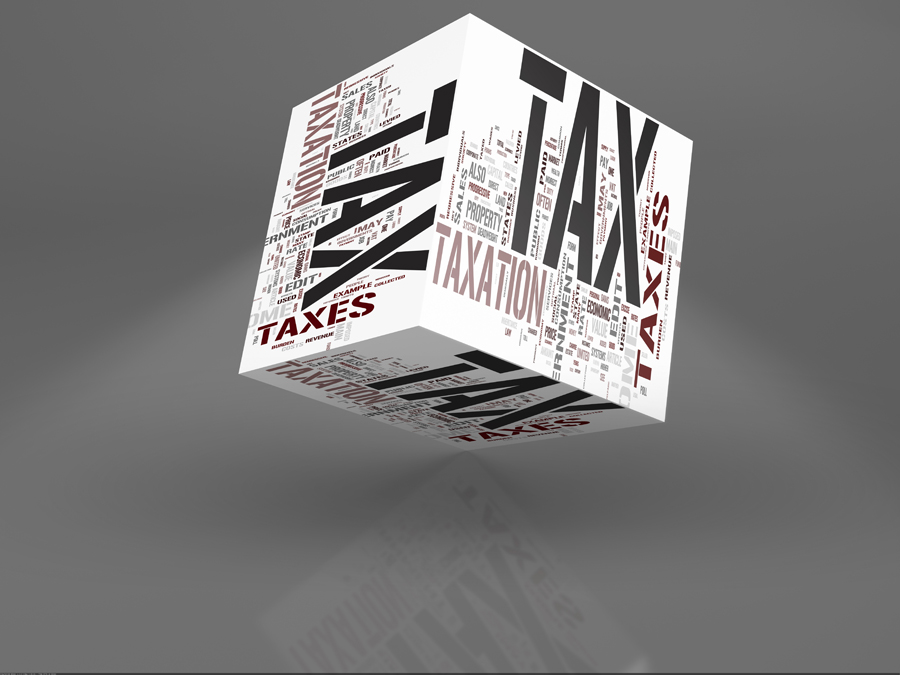 Block with Tax words on it